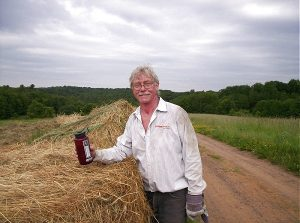 Grower & great friend Steve Hearth with hay bales used for mulch.